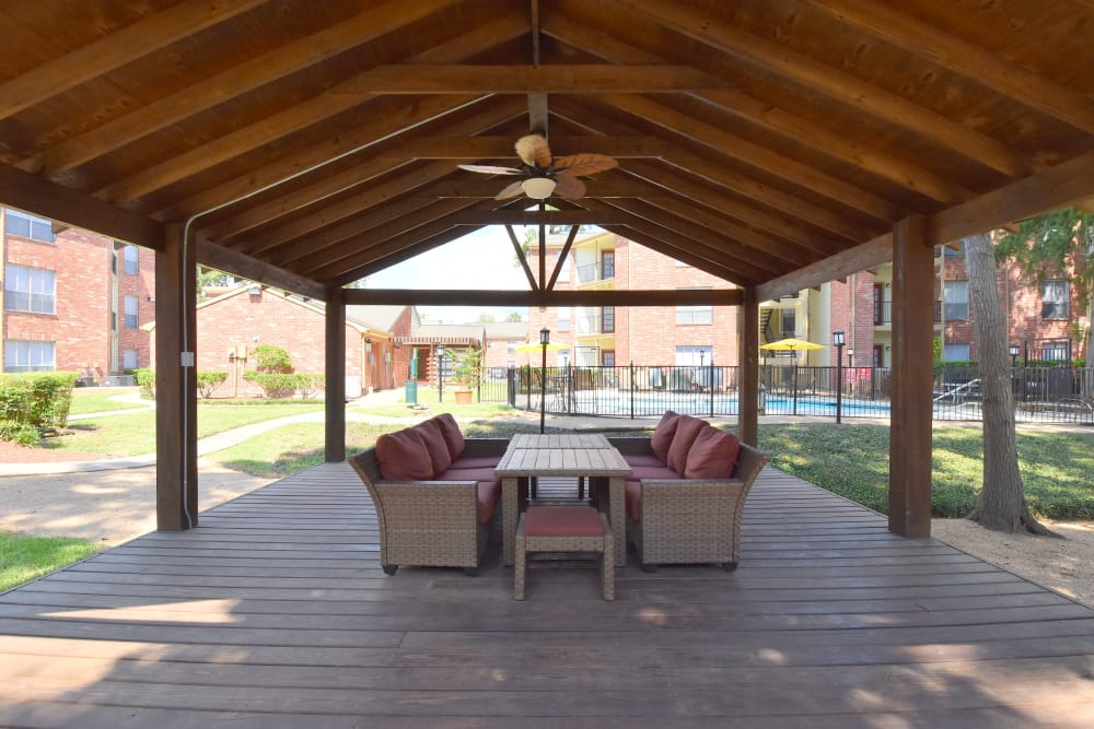 Covered outdoor seating area at Park at Deerbrook Apartments in Humble, TX