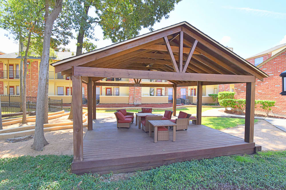 Covered sitting area at Park at Deerbrook Apartments in Humble, TX