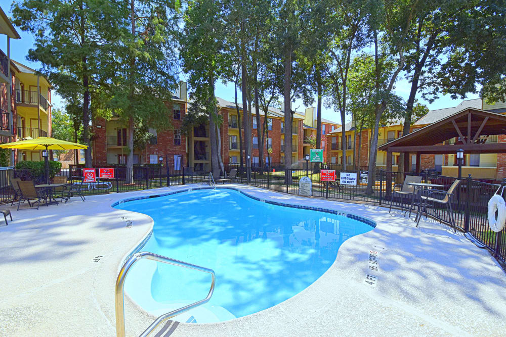 Sparkling pool at Park at Deerbrook Apartments in Humble, TX