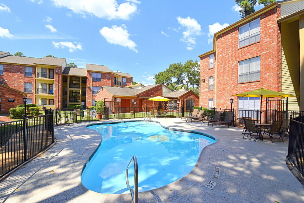 Enjoy our swimming pool at Park at Deerbrook Apartments in Humble, TX