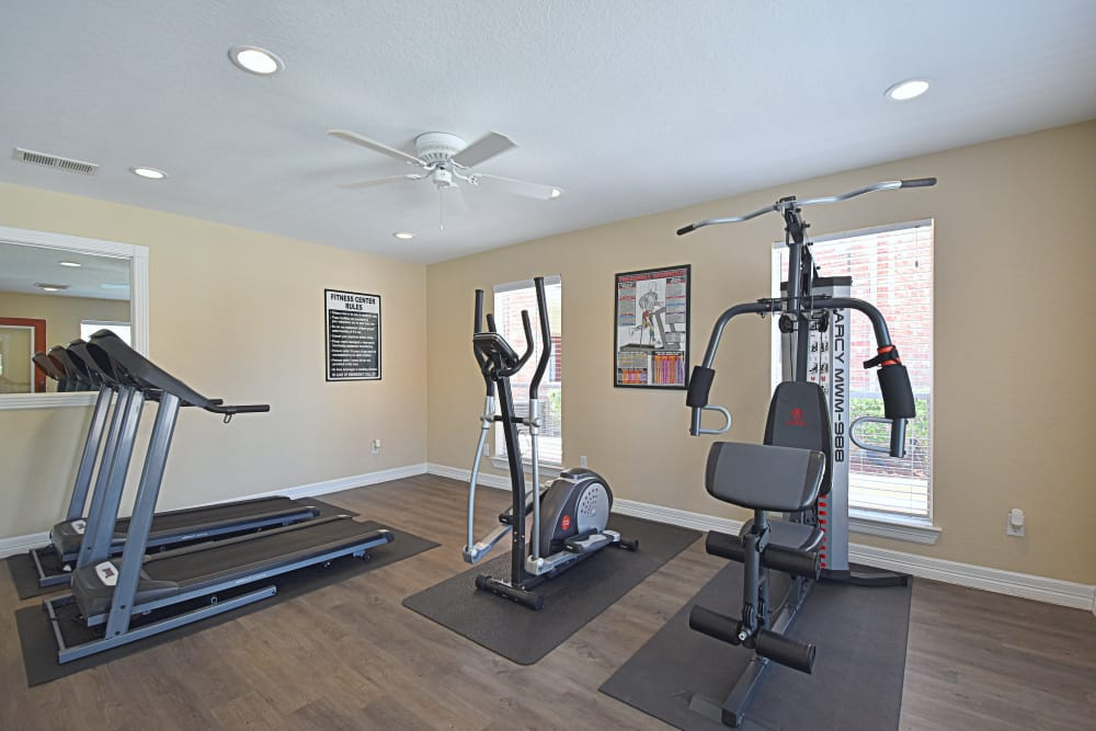 Fully-equipped fitness center at Park at Deerbrook Apartments in Humble, TX