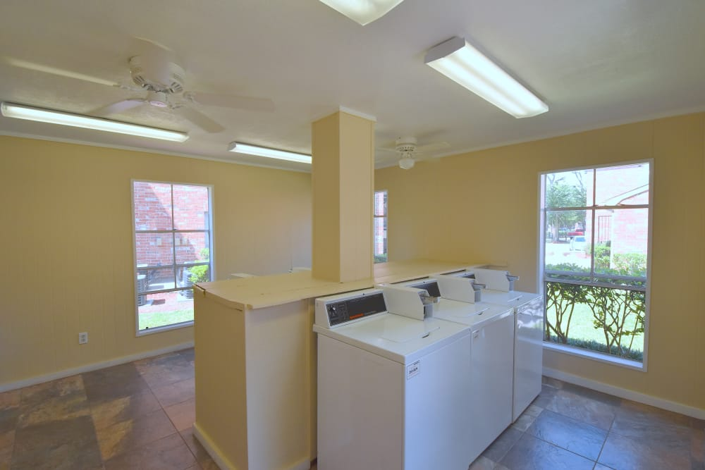 Onsite laundry facility at Park at Deerbrook Apartments in Humble, Texas