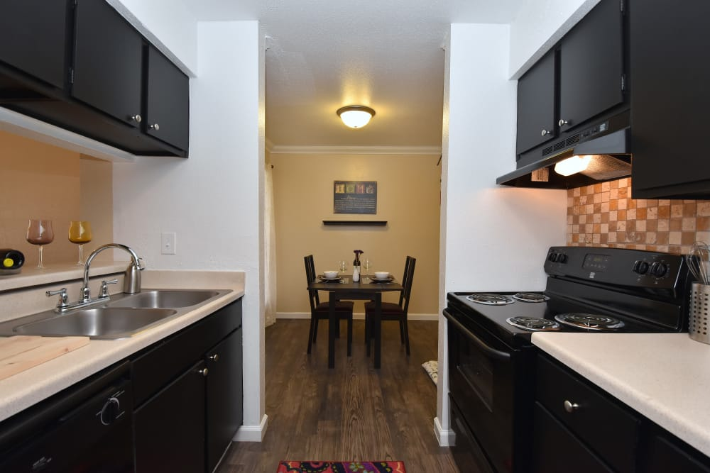 Kitchen and dining area at Park at Deerbrook Apartments