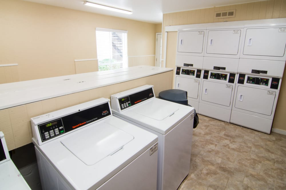 Fully equipped laundry facility at Bender Hollow Apartments in Humble, Texas