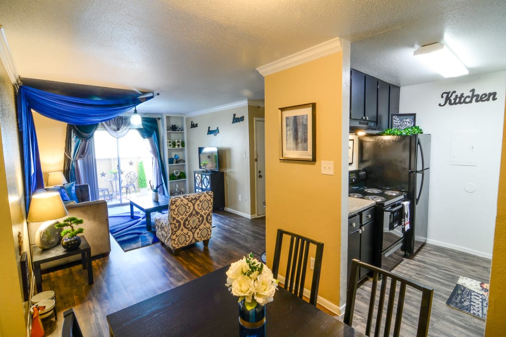 Sun-lit living and dining room at Bender Hollow Apartments in Humble, TX