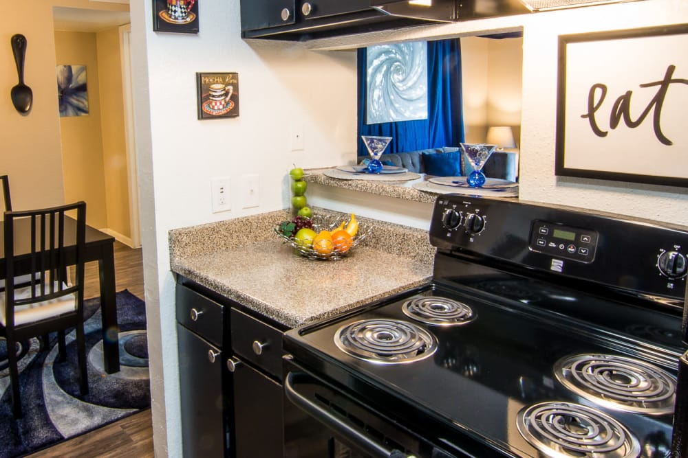 Fully equipped kitchen at Bender Hollow Apartments in Humble, TX