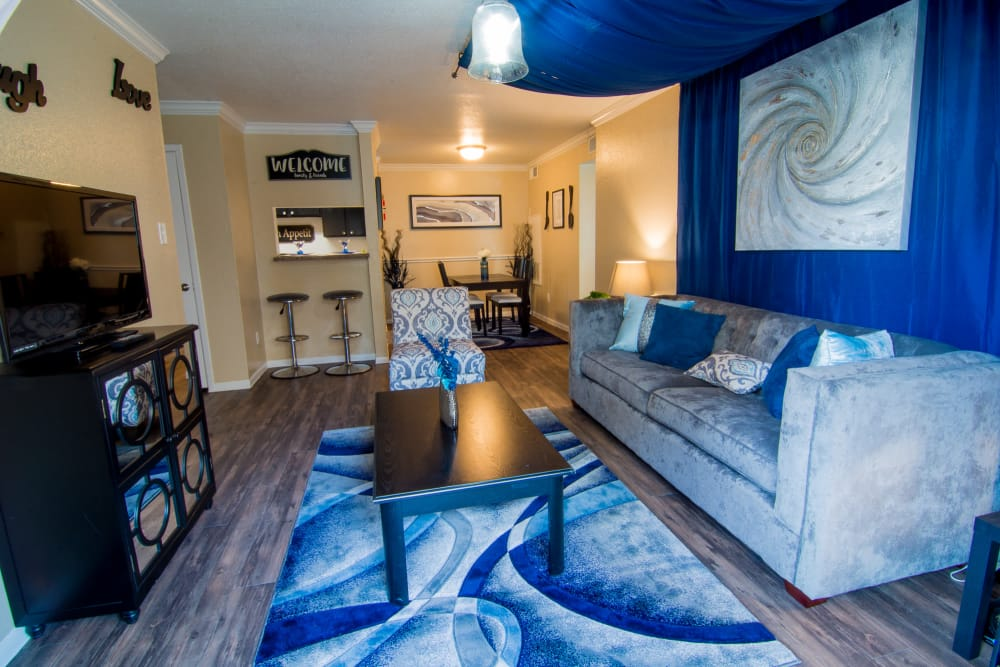 Bender Hollow Apartments offers spacious living rooms in Humble, TX