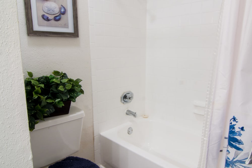 Bathroom with tub at Bender Hollow Apartments in Humble, Texas