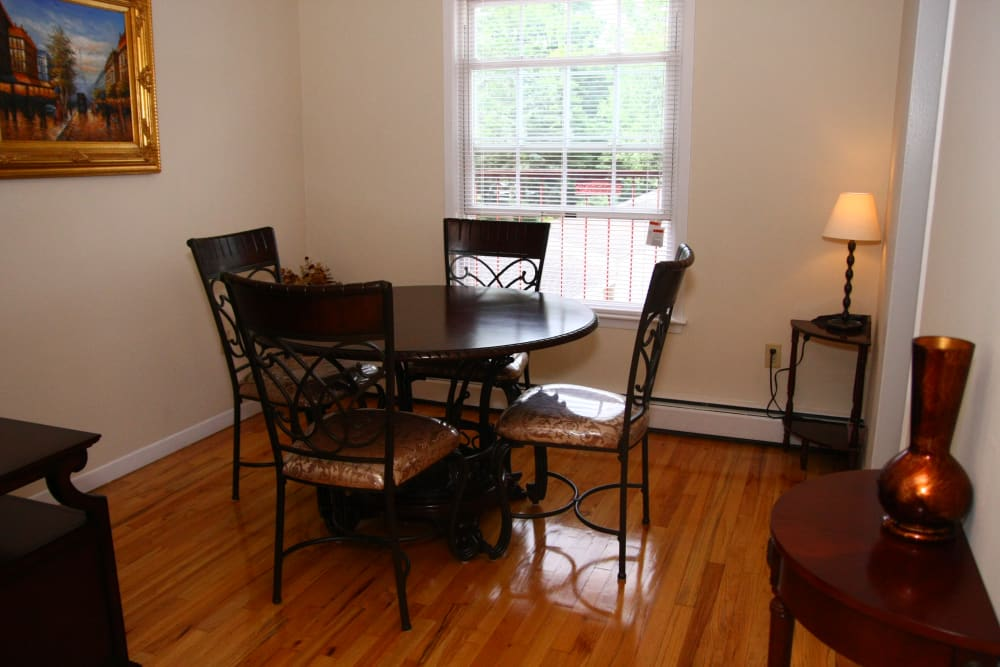A window next to the dining area is great for natural light at Jackson House Apartments