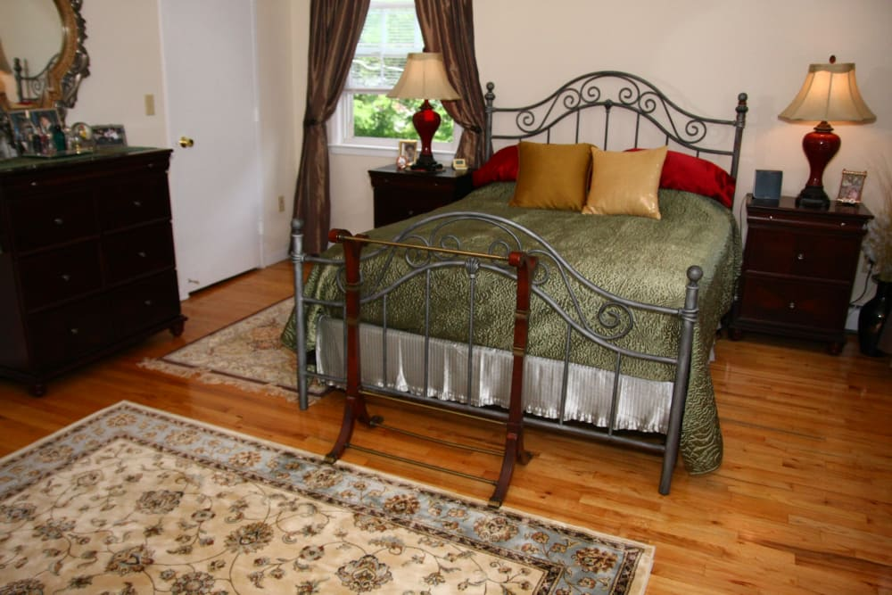 A model bedroom at Jackson House Apartments with nice hardwood flooring
