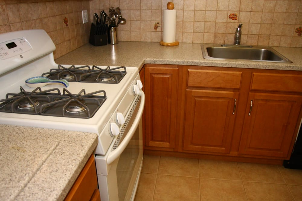 A gas range in the kitchen at Jackson House Apartments