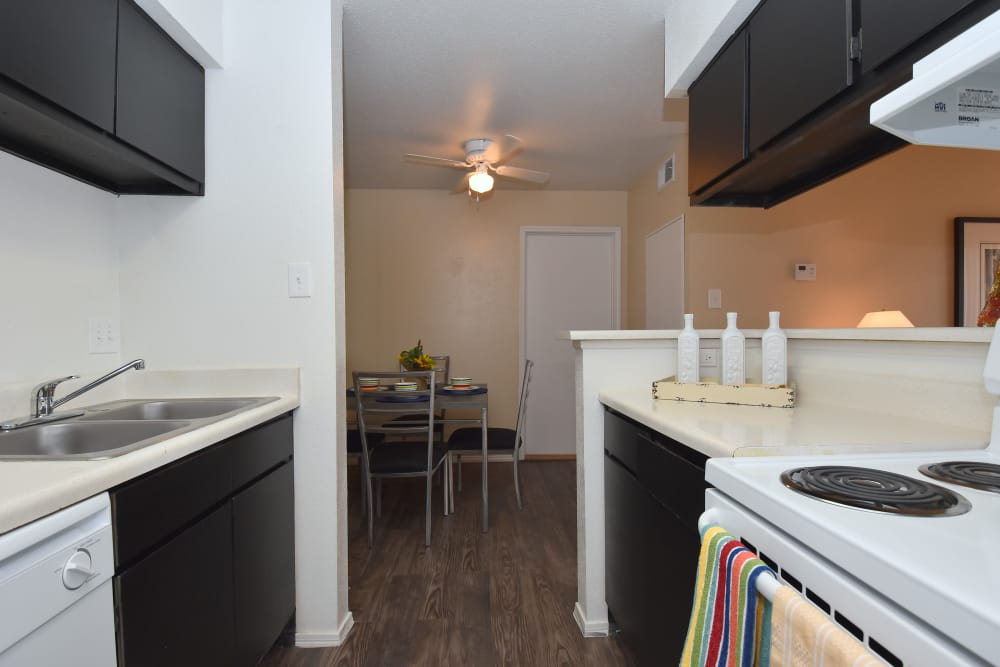 Kitchen and dining area at Brookmore Hollow Apartments in Rosenberg, Texas