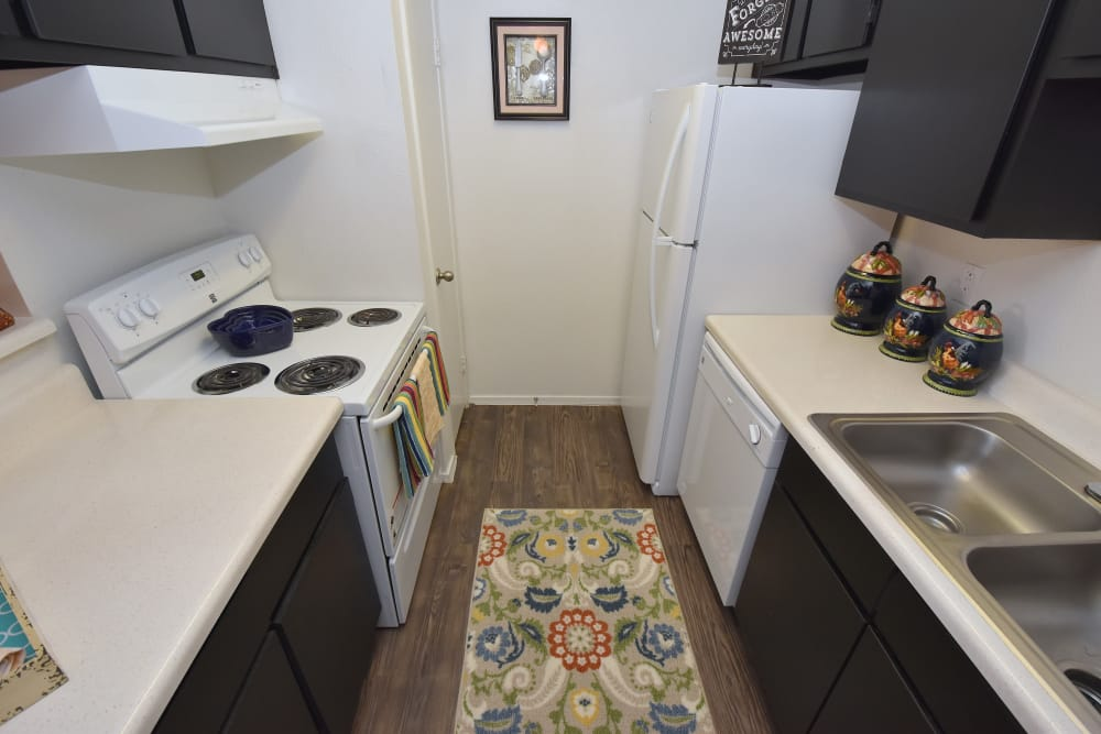 Kitchen at Brookmore Hollow Apartments in Rosenberg, Texas