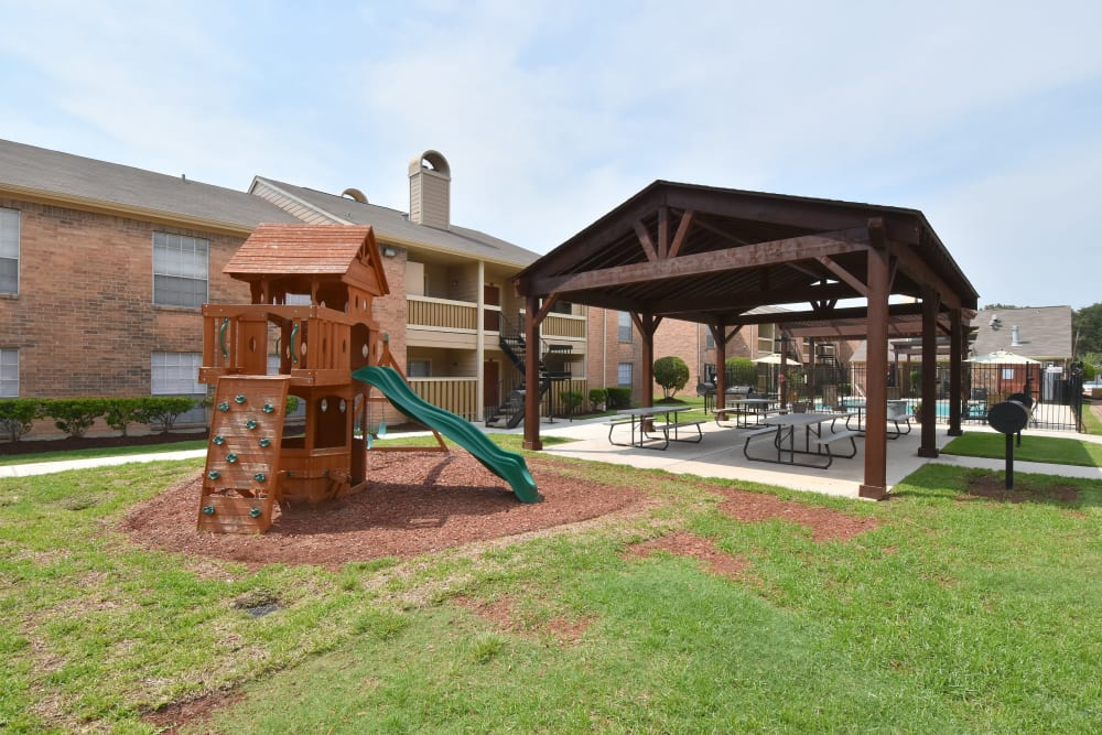 Brookmore Hollow Apartments offers a fun playground in Rosenberg, Texas