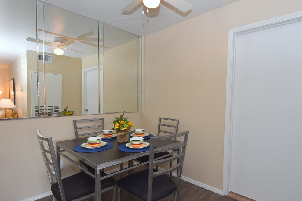 Dining room and kitchen at Brookmore Hollow Apartments in Rosenberg, Texas
