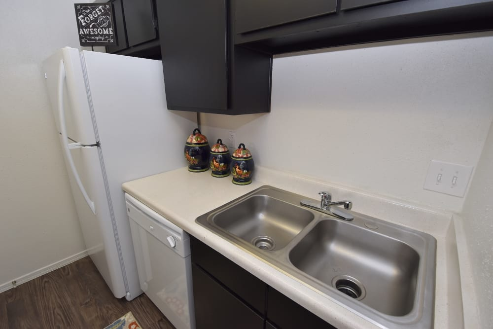 Brookmore Hollow Apartments comes with all white appliances in Rosenberg, Texas