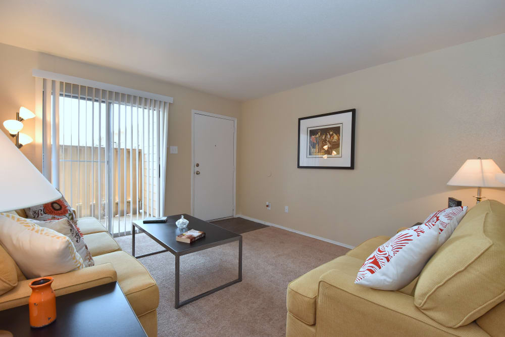 Apartment living room at Brookmore Hollow Apartments in Rosenberg, Texas