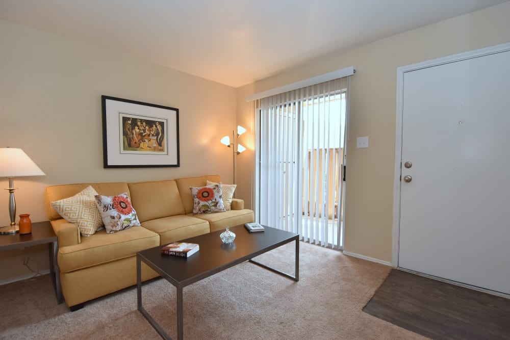Living room at Brookmore Hollow Apartments in Rosenberg, Texas