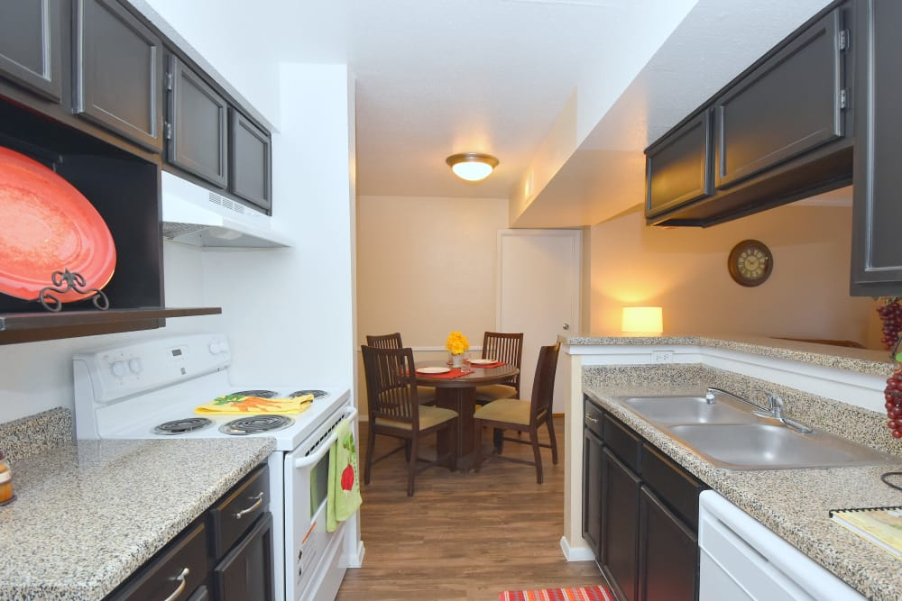 Cozy kitchen at Deerbrook Garden Apartments in Humble, Texas