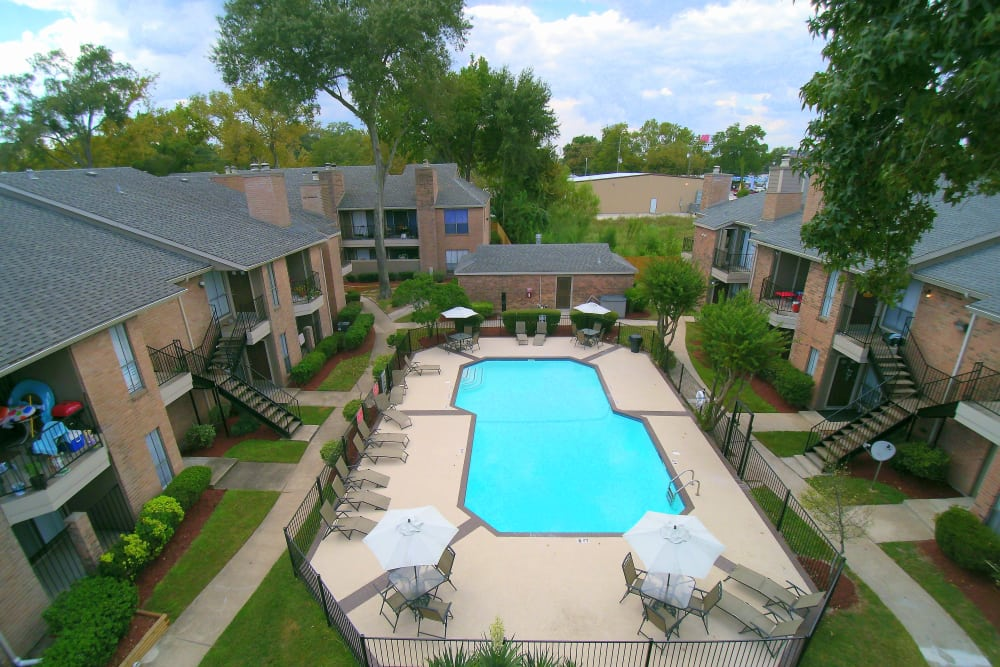 Aerial view of the Deerbrook Garden Apartments pool in Humble, Texas
