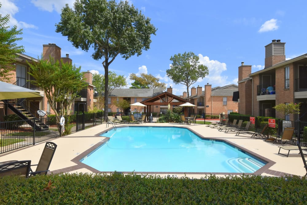 Sparkling pool at Deerbrook Garden Apartments in Humble, Texas