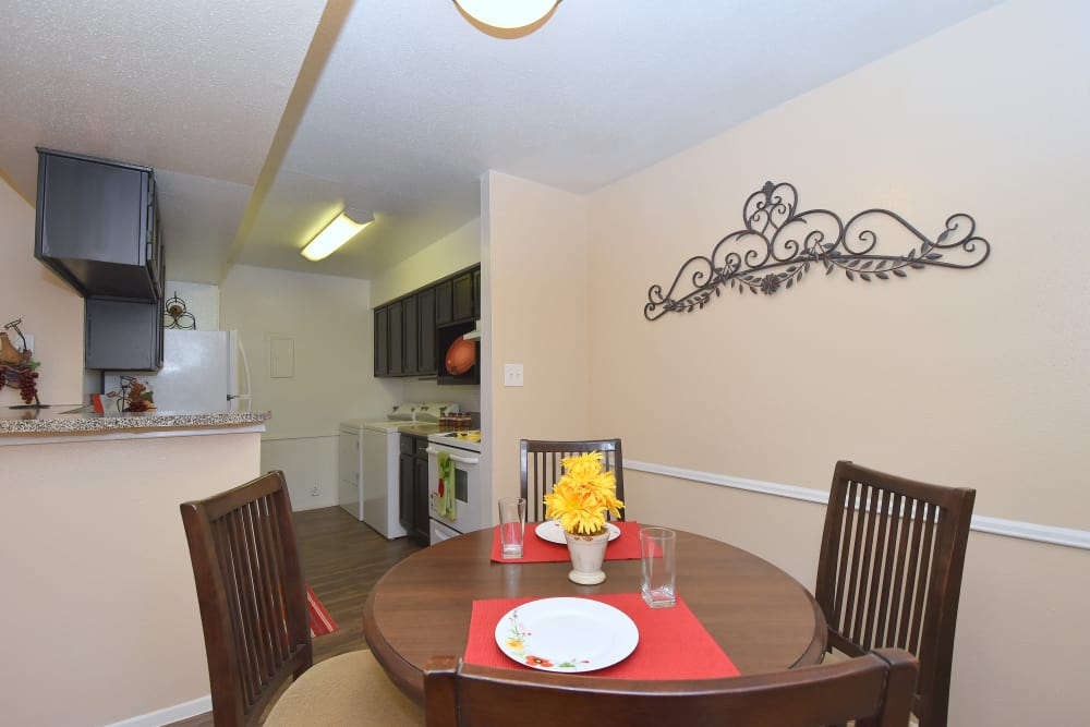 Dining and kitchen area at Deerbrook Garden Apartments in Humble, Texas