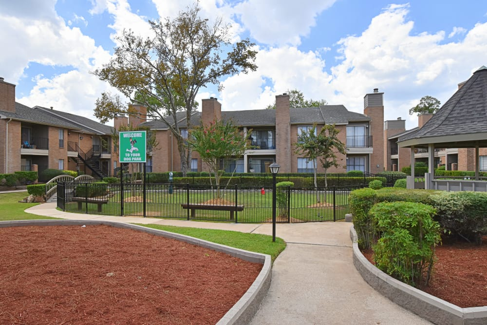 Side walk and dog park at Deerbrook Garden Apartments in Humble, Texas