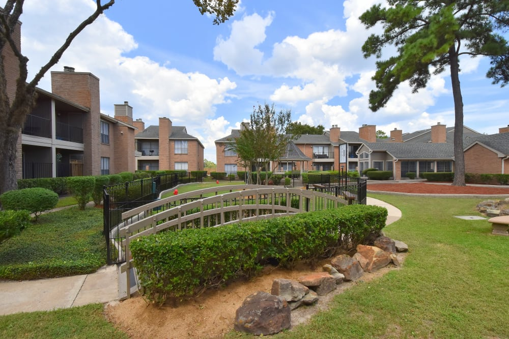 Deerbrook Garden Apartments bridge and courtyard in Humble, TX