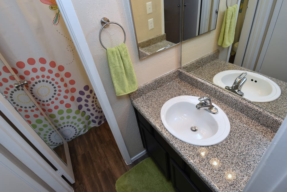 Bathroom sink at Deerbrook Garden Apartments in Humble, Texas
