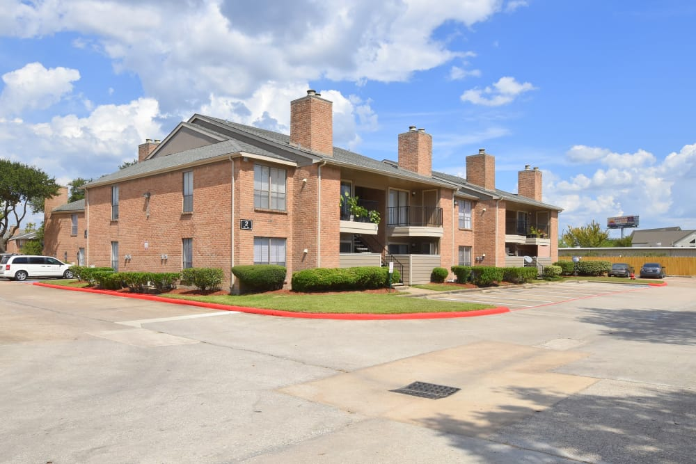 Exterior view of our buildings at Deerbrook Garden Apartments in Humble, Texas
