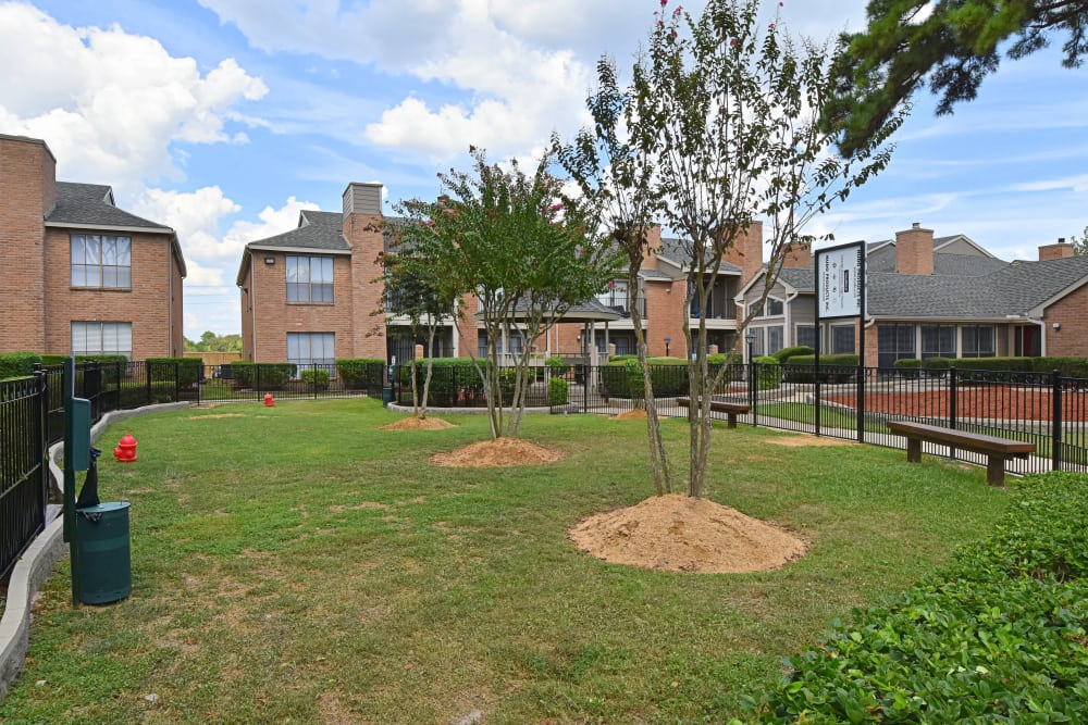 Dog park with grass at apartments in Humble, Texas