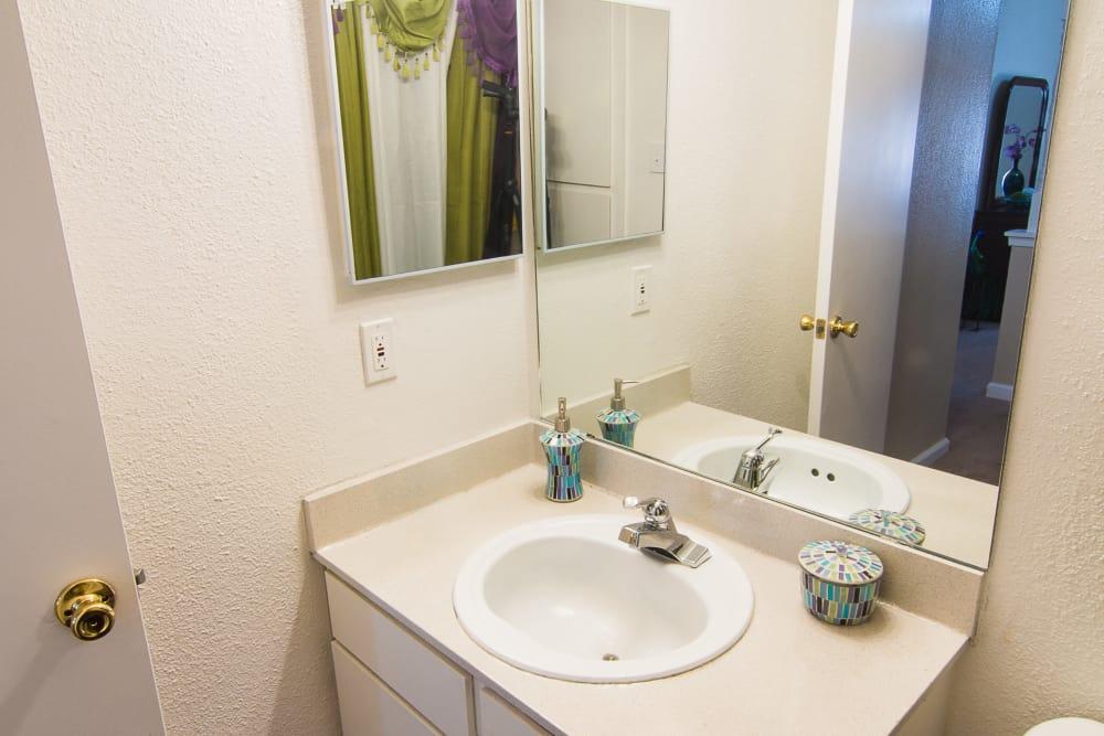 Bathroom sink at Northlake Manor Apartments in Humble, TX