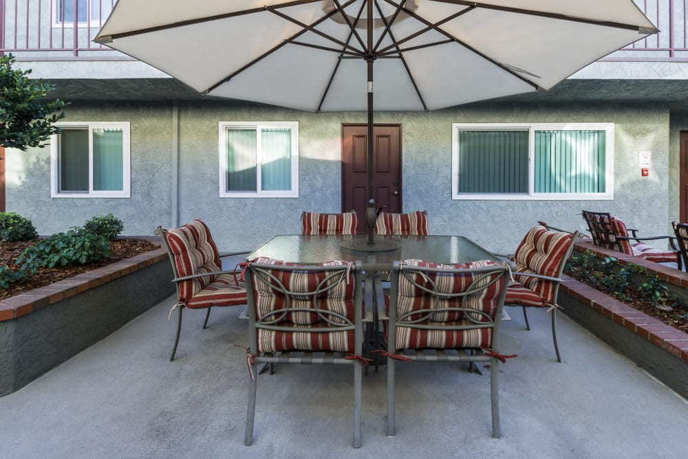Umbrella covered outdoor table and chairs at The Diplomat in Studio City, CA