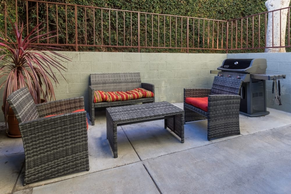 Outdoor seating area next to grilling station at The Diplomat in Studio City, California