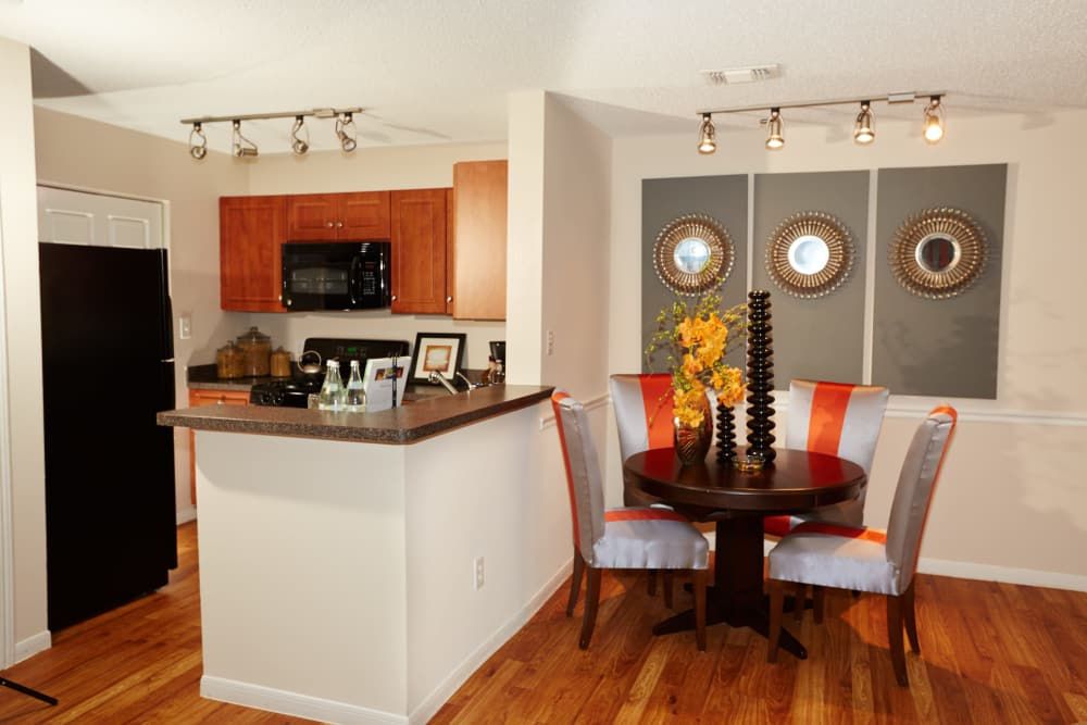 Well-equipped kitchen and beautiful dining area at Middletown Brooke Apartment Homes