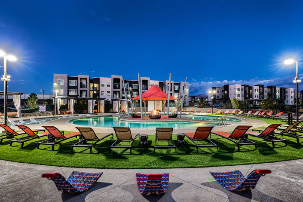 Enjoy apartments with swimming pool with seating at Zerzura Apartments in Las Vegas, Nevada