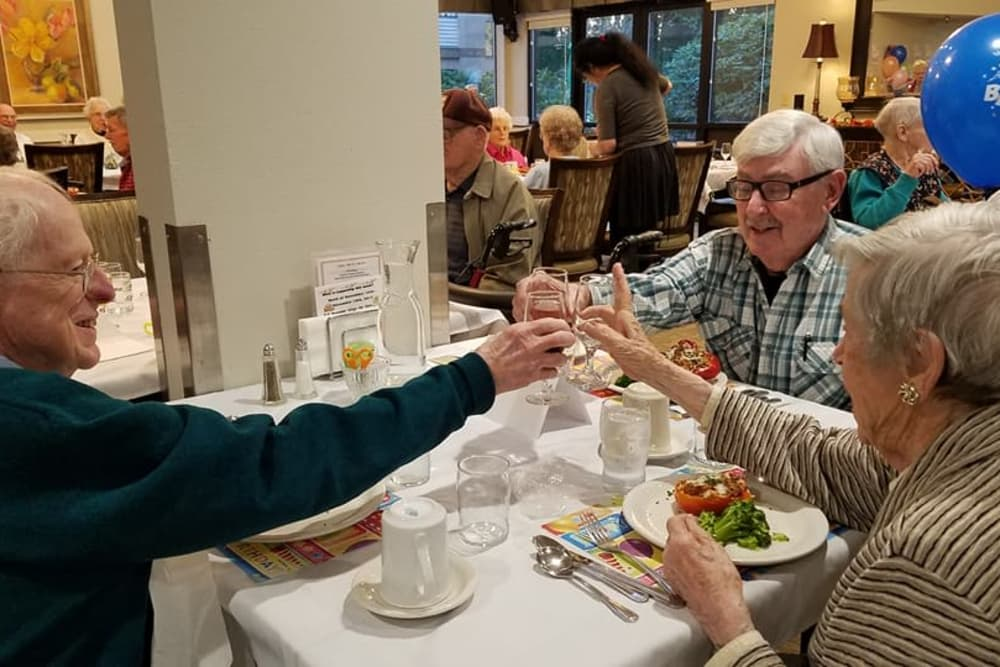 residents toasting during a meal