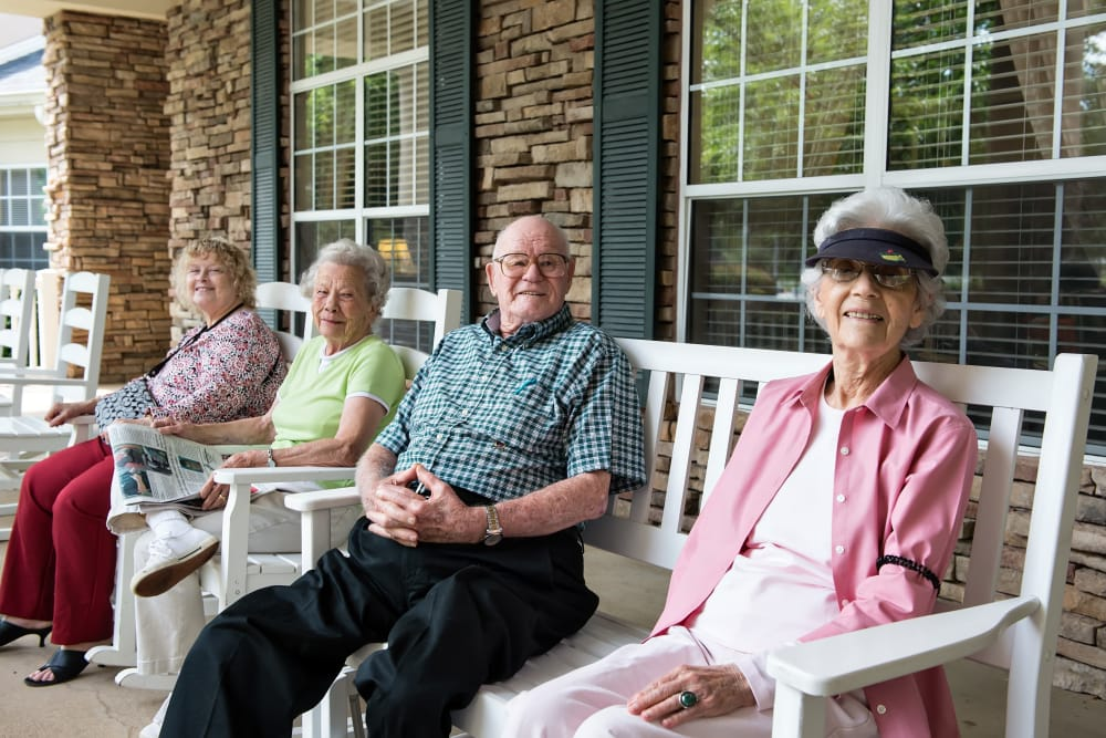 Residents outside enjoying the sun at Azalea Estates of Fayetteville