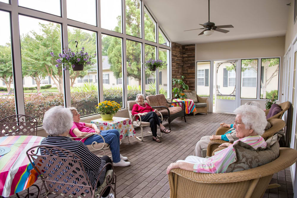 Residents in the sun-room at Azalea Estates of Fayetteville in Fayetteville, Georgia