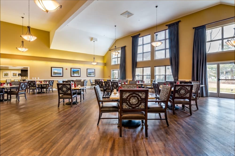 Spacious dining room with views to courtyard and activity room at Pacifica Senior Living Klamath Falls in Klamath Falls, Oregon