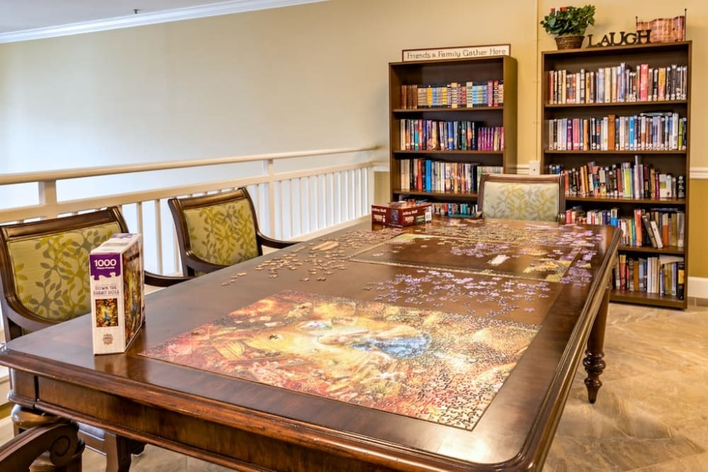 Puzzles and books for all to enjoy at Pacifica Senior Living Klamath Falls in Klamath Falls, Oregon