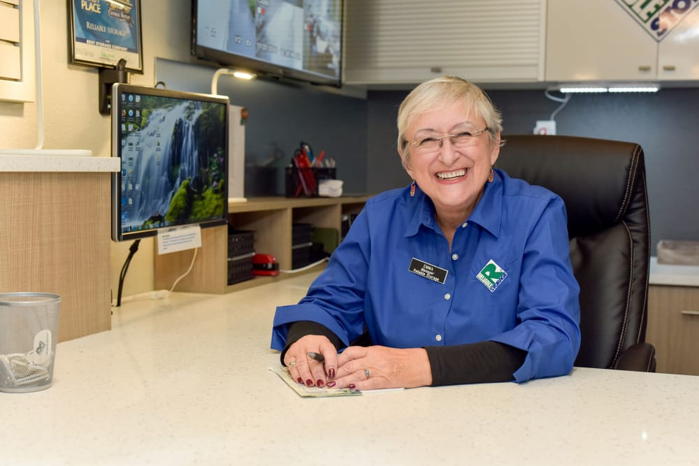 An employee working the front desk at Reliable Storage in Silverdale, Washington