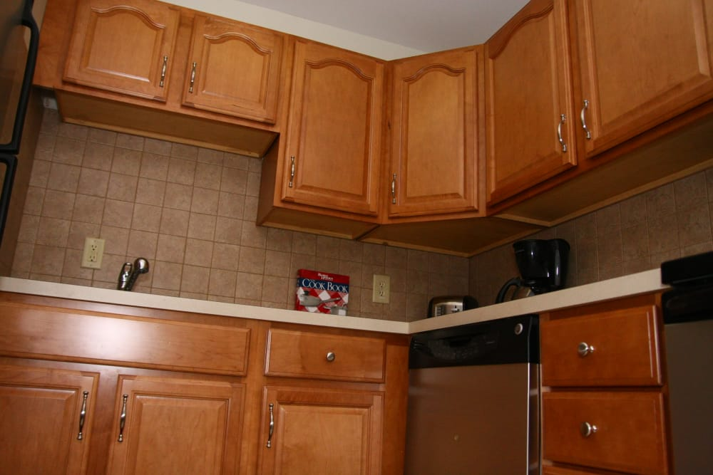 Kitchen at apartments with wooden cabinets in Bordentown, New Jersey