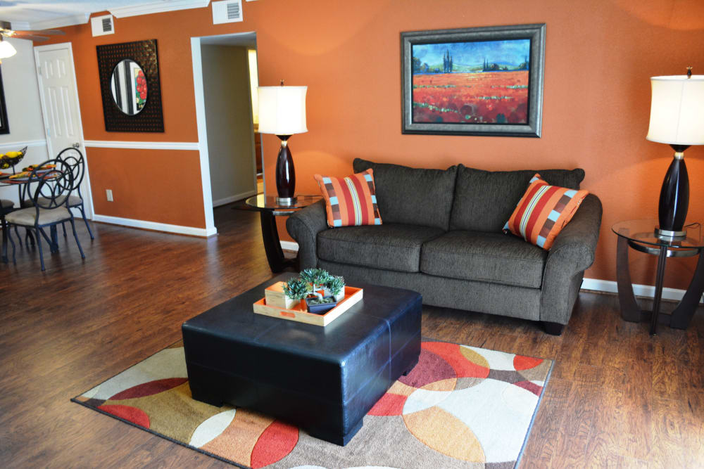 The Abbey at Riverchase spacious living room with wood floors Hoover, AL