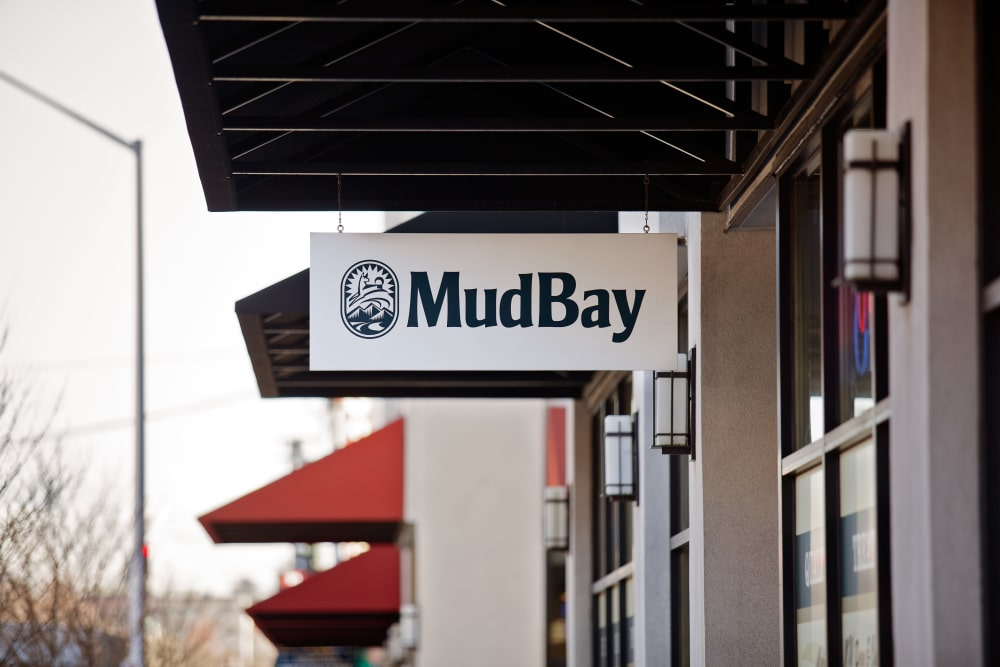 Mud Bay's sign outside their retail shop near Grant Park Village