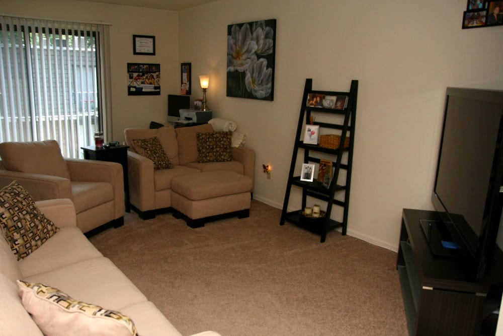 Beautiful living room with TV at North Hills Apartments