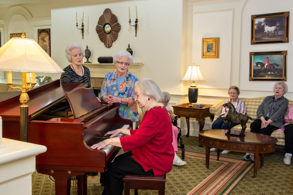 Residents gathered around the piano at Azalea Estates of Fayetteville in Fayetteville, Georgia