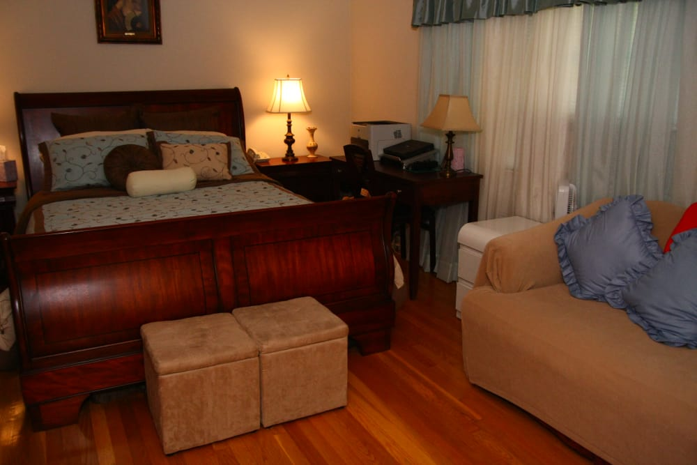 The master bedroom at Royal Court Apartments has ample space for a bed and couch