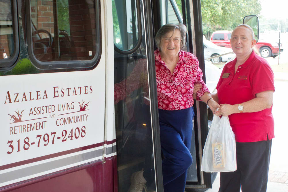 A resident boarding a bus at Azalea Estates of Monroe in Monroe, LA