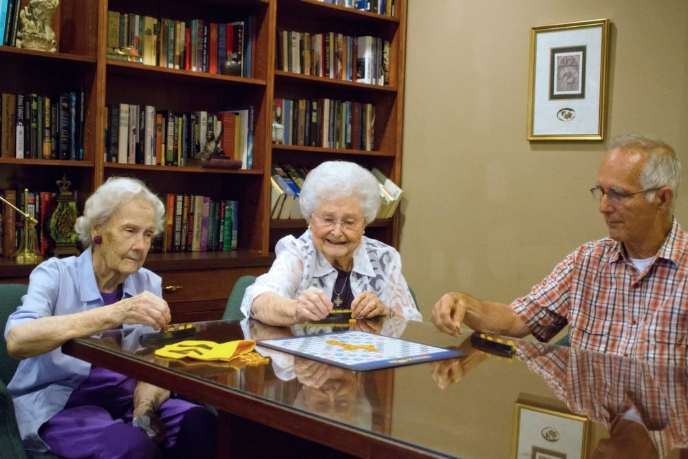 Residents playing a board game at Azalea Estates of Monroe in Monroe, LA